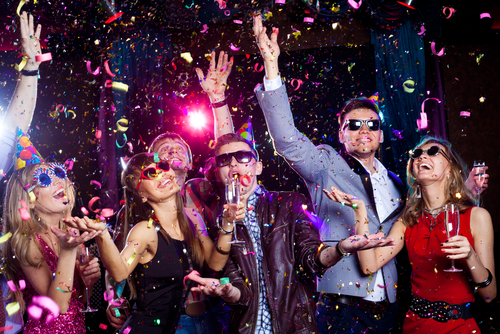 Cheerful young people showered with confetti on a club party.  shutterstock_139152893