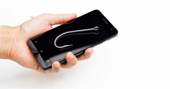 mobile phishing concept - a fish hook on a smart phone  Stock Foto: Bildnummer: 220097302  copyright by shutterstock.com