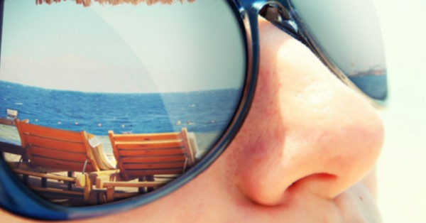 Reflection of a tropical resort in sunglasses by shutterstock.com
