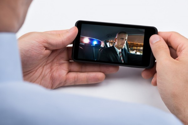 shutterstock_316980953 Close-up Of Person Watching Video On Mobile Phone by shutterstock.com