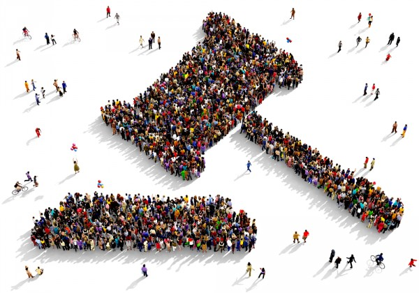 Large and diverse group of people seen from above gathered together in the shape of a judge gavel by shutterstock.com